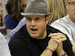 Kevin James, pictured here watching an NBA game, welcomed his first son Sunday.