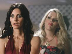 Courteney Cox, left, and Busy Philipps star in Cougar Town, about older women (cougars) meeting younger men (cubs)..