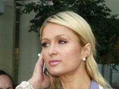"After Wednesday's incident, Paris Hilton tweeted that a ""psycho intruder just punched Cy in the back of the head as we were walking into the court house."""