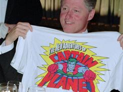 Famous fan?: Then-President Clinton geeks out over Captain Planet in 1995.