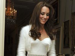 Kate wore a strapless number with diamante detailing around the waist, also by Sarah Burton for Alexander McQueen.
