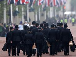 Police walk along the Mall ahead of the Royal Wedding of Prince William to Catherine Middleton at Westminster Abbey on April 29, 2011 in London.