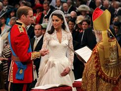 Prince William and Kate Middleton exchange traditional vows (minus her promise to obey) in front of the Archbishop of Canterbury.