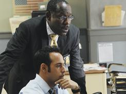 James McDaniel, back, and Shaun Majumder star in Detroit 1-8-7, a keeper on ABC.
