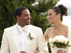 Time to celebrate: Laz Alonso, left, and Paula Patton lead the wedding party to the reception tent.