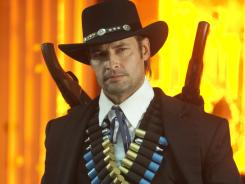 Sweating (paint) bullets: Josh Holloway finishes his run as Black Rider on 'Community' in Thursday's season finale.
