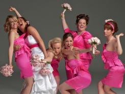 Kristen Wiig, left, Maya Rudolph, Wendi McLendon-Covey, Rose Byrne, Melissa McCarthy and Ellie Kemper are pretty in pink in 'Bridesmaids.'