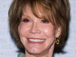 Mary Tyler Moore will have surgery to remove a benign brain tumor, a representative says.