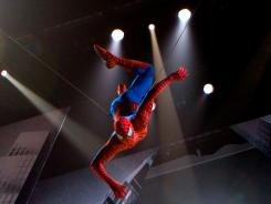 """Christopher Tierney portrays Spider-Man in a scene from the musical """"Spider-Man: Turn Off the Dark"""" in New York."""