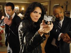 Rob Estes, left, Angie Harmon and Tyrees Allen in a scene from 'Women's Murder Club.'