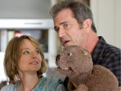 Jodie Foster not only stars but directs The Beaver. Mel Gibson plays her husband, a man who can  express himself only through a hand puppet.