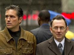 In Person of Interest, a presumed-dead former CIA agent (James Caviezel, left)  teams up with a mysterious billionaire (Michael Emerson) to prevent violent  crimes.