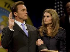 Maria Shriver stands with her husband, Arnold Schwarzenegger, as he is sworn in as governor of California on Jan. 5, 2007. The couple announced their separation last week.