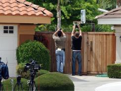 Paparazzi try to get photos outside the Bakersfield, Calif., home of Mildred Baena, the former maid who may have mothered a child with Arnold Schwarzenegger while he was married.
