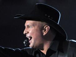 Garth Brooks performs for a charity concert in in 2008 in Los Angeles.