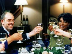 1999 flashback: Author Wally Lamb and Oprah Winfrey discuss his 'She's Come Undone' on her TV talk show.