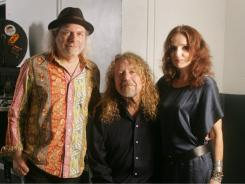 Robert Plant poses with Buddy Miller, left, and singer Patty Griffin before performing with Band Of Joy at Miami's Bayfront Amphitheatre.
