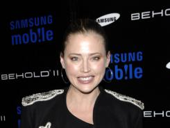 Estella Warren was in a Los Angeles jail Tuesday after police said she crashed her car, attacked an arresting officer and tried to flee from custody.