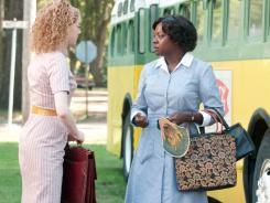 Emma Stone, left,  as Skeeter Phelan and Viola Davis as Aibileen Clark star in 'The Help,' based on the best-selling novel by Kathryn Stockett.