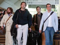 One night in Bangkok: Zack Galifianakis, left, Bradley Cooper, Justin Bartha and Ed Helms stumble into more outrageous high jinks in the sequel to 2009's comedy smash.