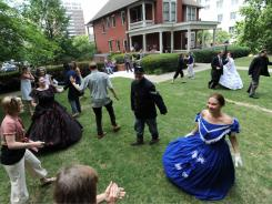 Visitors learn to dance the  Virginia Reel outside the Margaret Mitchell House in Atlanta, where Gone with the Wind was written.