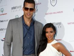 Kim Kardashian shows off the new bling she received from fiance Kris Humphries.