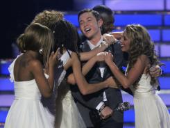 Winner Scotty McCreery is congratulated by other American Idol contestants during the season  finale  May 25.