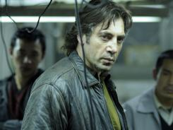 Javier Bardem plays a devoted father, and a criminal dying of cancer, in Biutiful.