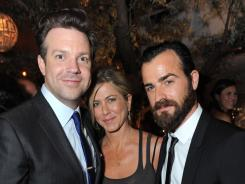 New Hollywood couple Jennifer Aniston and Justin Theroux, right, joined Jason Sudeikis on Sunday night at an afterparty following the MTV Movie Awards.
