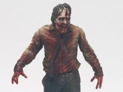 The Zombie Biter, in stores in November, is a new Walking Dead action figure based on an undead character from the hit AMC show.