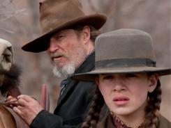 Jeff Bridges and Hailee Steinfeld pursue a murderer in the Coen brothers' True Grit.
