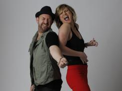 Sugarland, Kristian Bush and Jennifer Nettles, pose for a portrait before performing at the 2011 CMA Music Festival in Nashville on Friday.