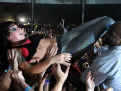 Singer Alexis Krauss of Sleigh Bells climbed into the crowd during the duo's performance. The fans then passed her back to the stage.