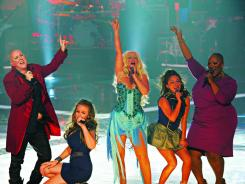 Beverly McClellan, left, Lily Elise, singing coach Christina Aguilera, Raquel Castro and Frenchie Davis perform.