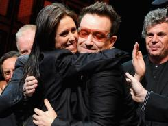 Director Julie Taymor and Bono hug it out the opening of 'Spider-Man Turn Off The Dark.'