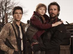 Drew Roy, left, Maxim Knight and Noah Wyle in a scene from the new TNT sci-fi series 'Falling Skies,' which premieres Sunday.