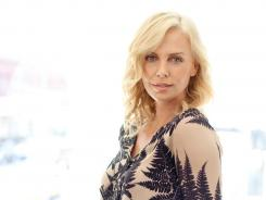 Always on the go: Charlize Theron works hard doing charity work in Africa, and with three movies coming up, she's also hard at work in front of the camera