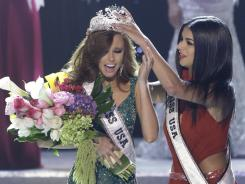 Alyssa Campanella, Miss California, is crowned as the 2011 Miss USA by Miss USA 2010 Rima Fakih on Sunday in Las Vegas.