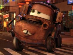 """""""Modern-day Goofy character"""": Mater (voiced by Larry the Cable Guy) in 'Cars 2,' which follows him around the globe as he is mistaken for a secret agent."""