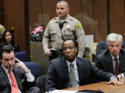 Conrad Murray appears in a Los Angeles court in January between defense attorneys Edward M. Chernoff and John Michael Flanagan for an arraignment hearing in January.