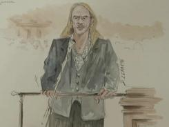 In this courtroom sketch, former Dior designer John Galliano is seen taking the stand Wednesday in Paris.