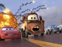 Race car Lightning McQueen (voiced by Owen Wilson), tow truck Mater (Larry the Cable Guy) and spy car Finn McMissile (Michael Caine) in 'Cars 2,' which earned $68 million.