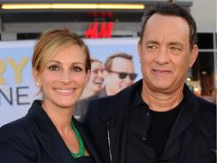 Julia Roberts and Tom Hanks arrive at the 'Larry Crowne' premiere.