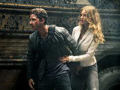 Sam Witwicky (Shia LaBeouf) and Carly (Rosie Huntington-Whiteley) try to keep a stealthy profile in 'Transformers 3.'