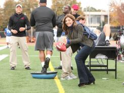 Dani (Callie Thorne) kicks out her cheating husband, she meets football trainer Matthew (Marc Blucas, far left), who helps her land a job counseling one of the players.