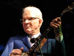 Steve Martin plays with the Steep Canyon Rangers June 23 at the River of Music Party in Owensboro, Ky.
