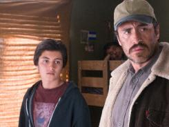 Son and father: Jose Julian, left, and Demian Bichir strive for a better life in Los Angeles.