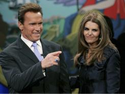 This 2007 file photo shows Maria Shriver with Arnold Schwarzenegger before he is sworn in for his second term as governor. Shriver filed for divorce July 1, 2011.
