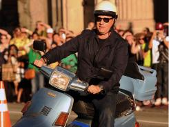 Tom Hanks cruises into the 'Larry Crowne' premiere Monday.