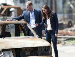 On their day off:  The duke and duchess inspect damage in Slave Lake, Alberta.
